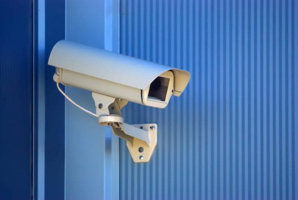 security camera on the blue wall