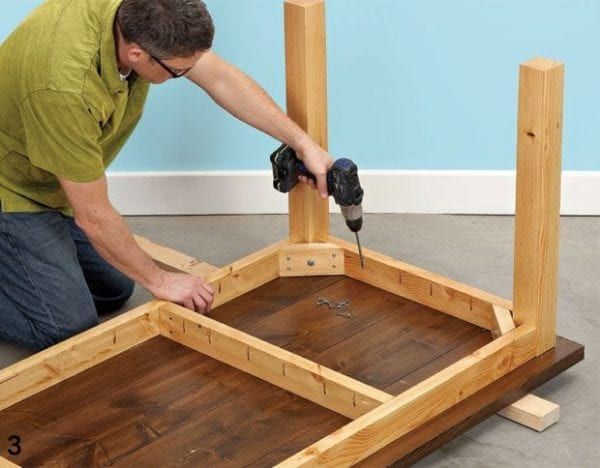 a handyman assembling a table
