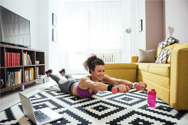 a woman working out in her living room
