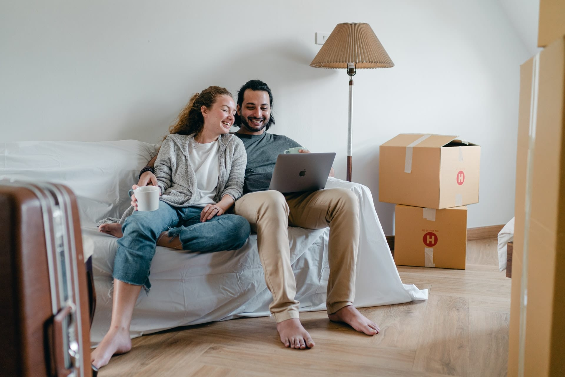 man and woman sitting around boxes