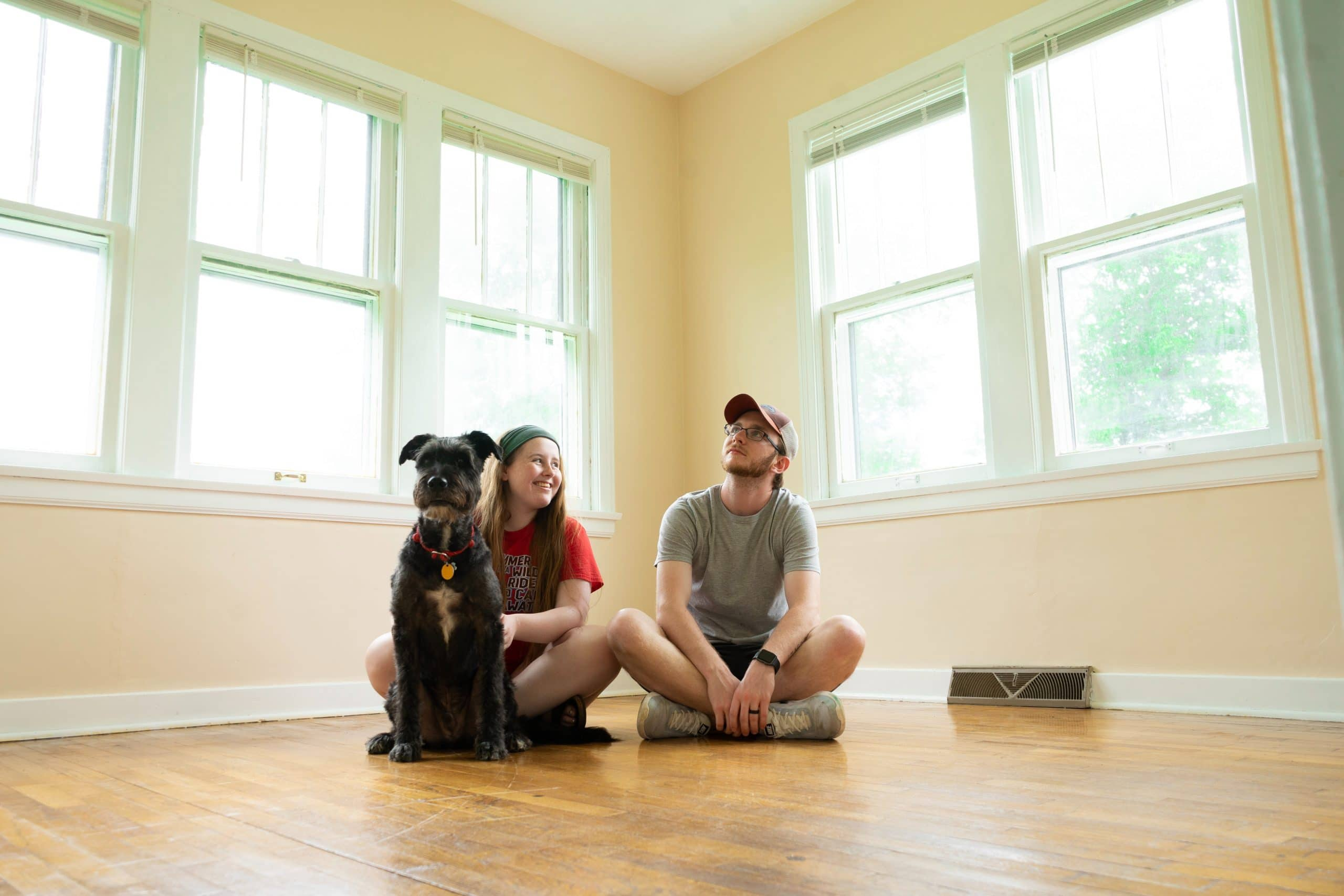 man and woman sitting in floor