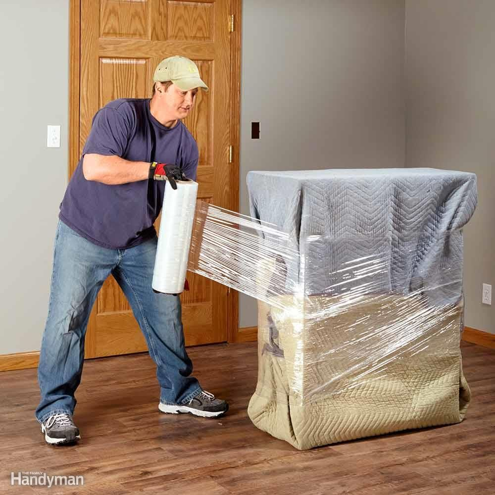 Man wrapping a huge box